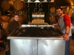 My Syrah foot-stomping buddies with the very full bin of juice.