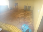 The steamy photo of the hardwood floors in the living room being removed.