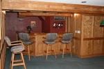 Directly below the previous rooms are a bar, game room & media room...real wood paneling and an oak bar.