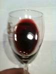 Deep red with a rusty halo: Sangiovese, Syrah, Corvina, Rondinella, and Nero d'Avola grapes