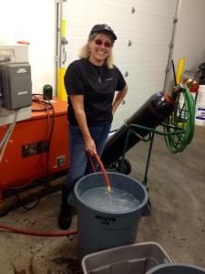 #6: Dawn preparing the cleaning solutions, one basic and one acidic, to clean the equipment with.