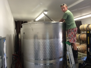 #7: Jason, winemaker, cleaning the stainless steel tank in preparation for the juice.