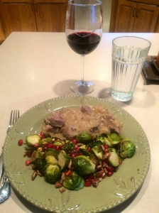 The wine suggested the dinner: braised lamb with sautéed onions and brussel sprouts with pecans and pomegranate.