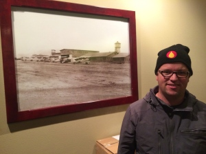 Marcus Miller, Airfield Estates wine maker,  with the photo of the WWII hangers still on his family's farm.