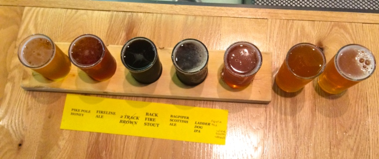 Left to Right: Pike Pole Honey, Fireline Ale, Back Fire Stout, Bagpiper Scottish Ale, Ladder Dog IPA, Apple Ale, and Wind Farm Wheat are Fire & Irons Brew Pub current offerings.