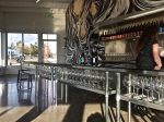 Chapter 24 tasting room is a sleek, modern space with a fabulous mural as its central focal point.
