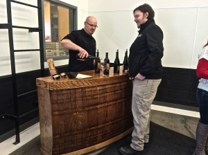 J&J Vintners co-owner Jody, pouring his wine behind the bar he created from old barrels - such talent! Go, Jody!