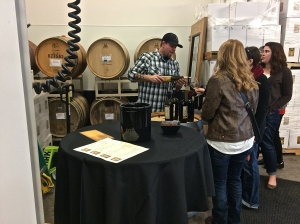 J&J Vintners co-owner Jeremy, pouring his wines in the barrel room of the new production facility at the WW Incubators.