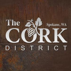 The Cork District, Spokane, WA logo care of their Facebook page.