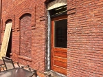 Original 1910 door was found encased in brick, now it leads to the patio on the west side of Plumb Cellars.