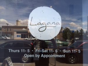 Lagana Cellars window logo and hours of the tasting room.