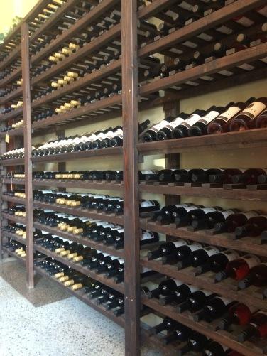 Wine bottles on open shelves; Locati Cellars.