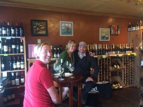 Evergreen Wine Cellar owner, Pam, with Jason and Brian.