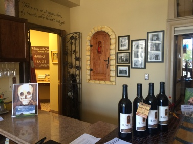 The door, Locati Cellars logo, welcomes one and all to come and enjoy the wine.
