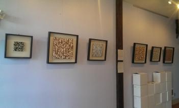 Mixed media wall hangings by Todd Bernave in Lagana Cellars tasting room.