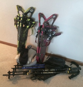 Snowshoes, poles, and gaiters ready for some snow.