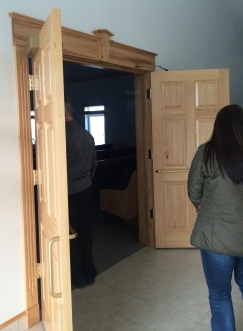 Maple doors and trim welcome all into the Stanfield Hutterite church.