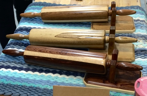 Maple, walnut and myrtle wood rolling pins and holders made by the Stanfield Hutterites.