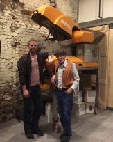 Owner Darby with winemaker Jerry in front of their new crusher destemmer machine.