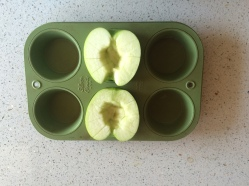 Use a muffin tin to support the apple halves as they slowly cook in a low heat oven.