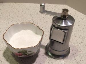 Salt cellar and pepper grinder.