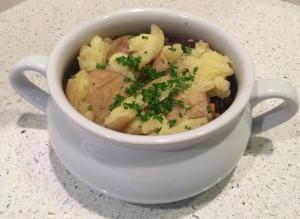 Irish stew with potatoes and parsley.