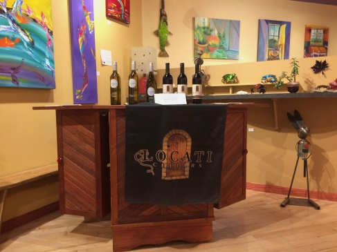 Wine pouring at Dragonfire Gallery.