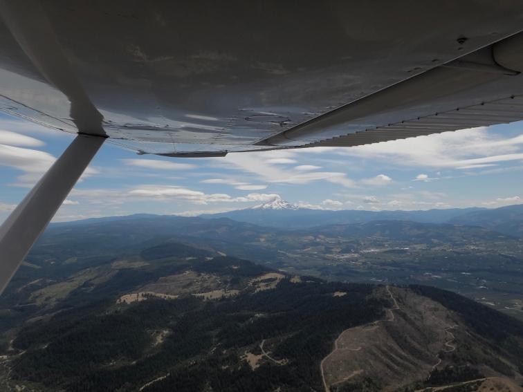 Mt Hood shedding cloud cover.