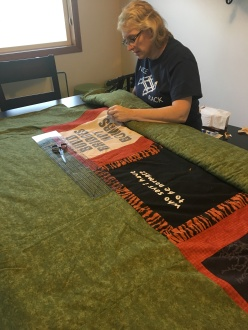 Using embroidery floss to tie the quilt so nothing shifts.